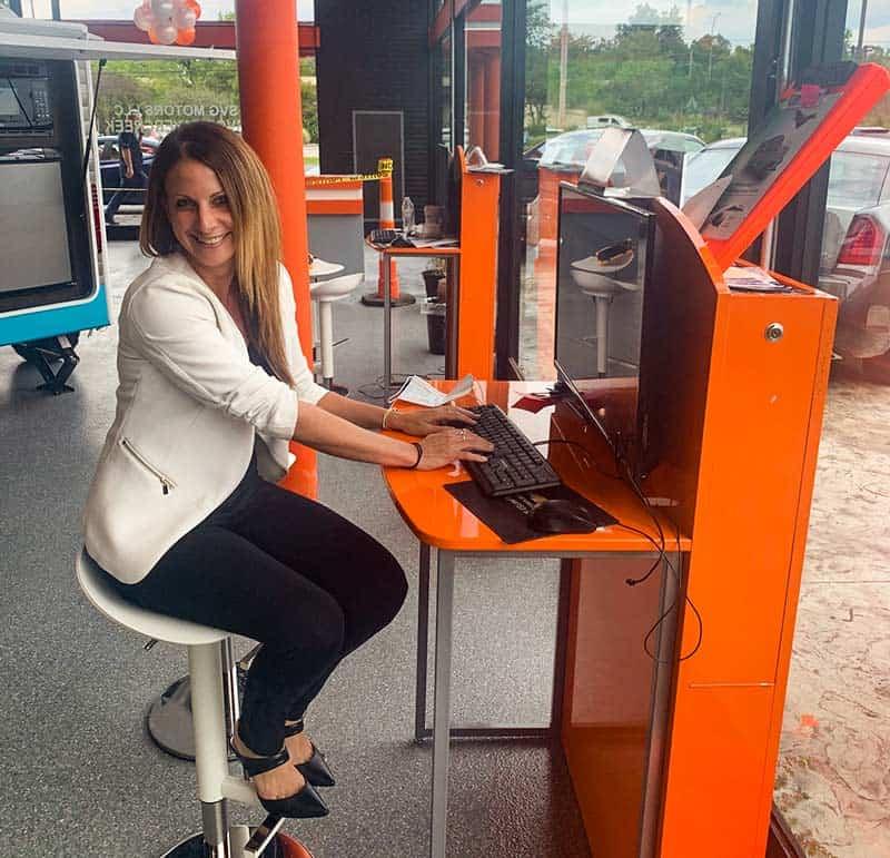 gail rubinstein working at desk sales center dealership